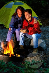 Couple In Front of Campfire