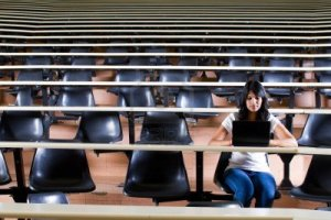 9843976-female-college-student-alone-in-university-lecture-hall