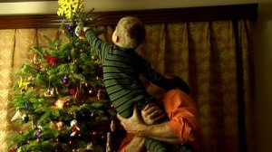 stock-footage-father-helping-son-decorate-christmas-tree