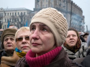 A woman cries as she attends a rally at Independence Square in Kiev