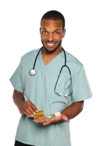 African American Health Professional With Prescription Pills